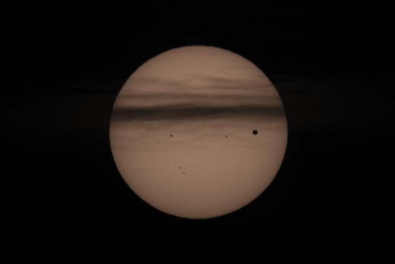 Sun ducks behind clouds as Venus transits