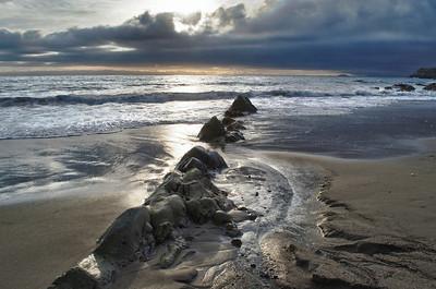 Moody sky, rocky coast in Malibu