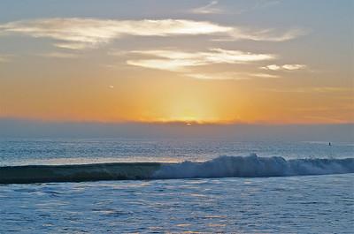 Sun sinking behind a fog bank, Ventura, California