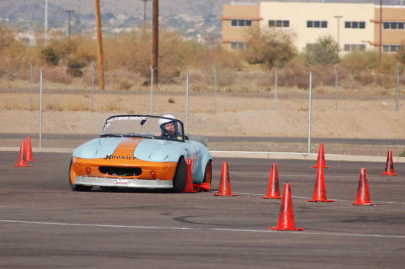 Lotus Elan sideways. The line of cones is going to vanish in the next shot. This is hands down my favorite car from today.
