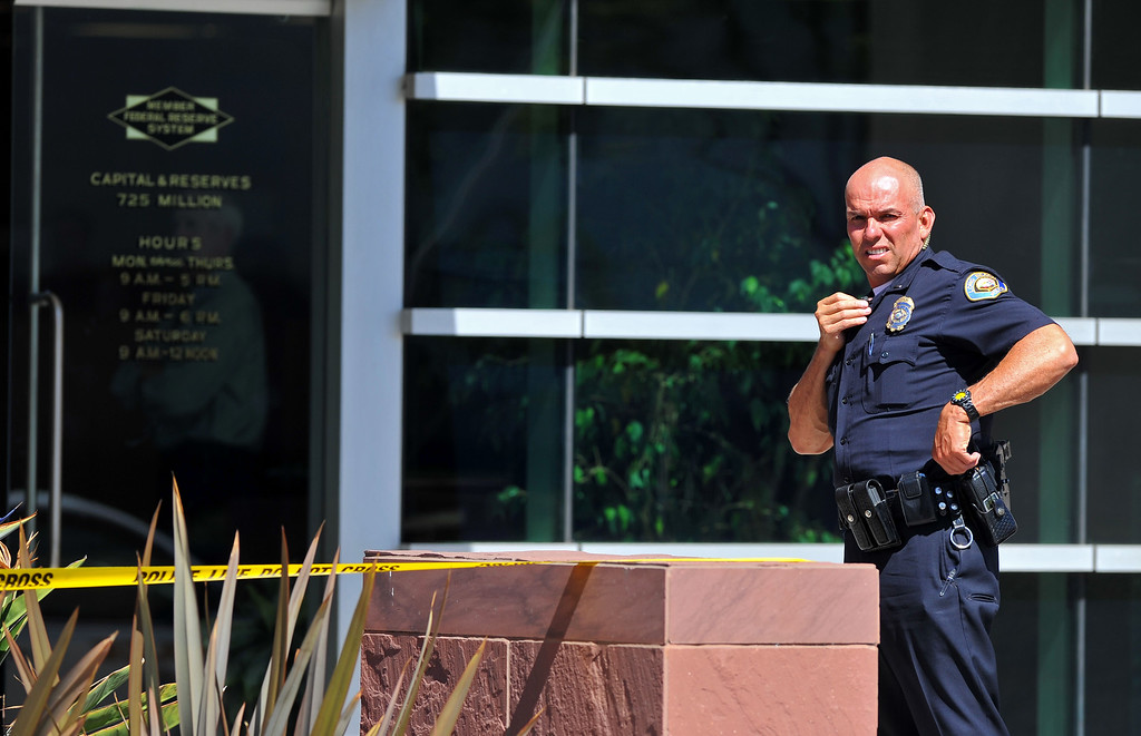 . The F&M Bank at 23rd and Bellflower was robbed around noon in Long Beach, CA on Tuesday, October 1, 2013 and the suspect got away with an undisclosed amount of cash.   (Photo by Scott Varley, Daily Breeze)