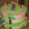 Safari style baby shower cake with toy animals