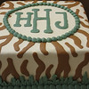 Monogram style safary and jungle baby shower cake