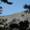 A line of hikers heading up the 'narrows' on the Bear Canyon Trail