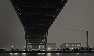 Under The Hoan Bridge. View of Milwaukee Sewage Treatment Facility.