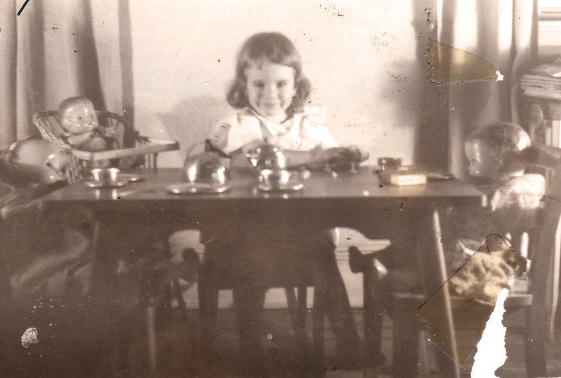 Barb: tea party with dolls. Abt age 4.