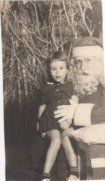 Barbara with Santa Claus abt age 3