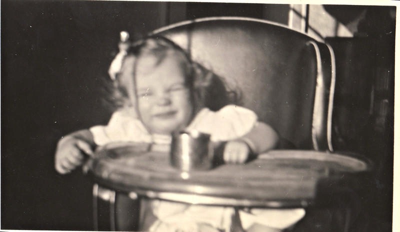 Barbara in Pat Rose's high chair abt 1 year