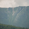 Zoom of The Saddle Trail from Sandy Stream Pond-center rock slide is the trail...
