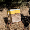 Commercial bee hives placed near farmlands to aid pollination of crops