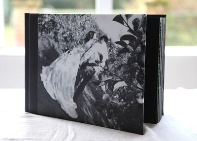 This book has a photocover on it - it is subtly different to the Imagewrap.  The image on this one just runs to the spine and is slightly padded. Then there is a black leatherette that wraps around the spine and the back of the book