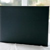 This is a plain black leatherette cover which wraps right the way around the book - you could emboss this if you wanted to