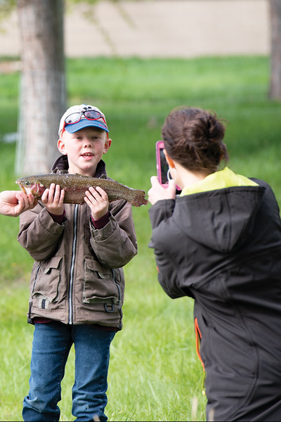 Matthew Gaston | The Sheridan Press<br>Six and a half-year-old Ames Davidson, a student at Big Horn Elementary School, poses for photo with a trout he caught at Wilson Reservoir on a field trip hosted by the Lions Club Thursday, May 23, 2019.