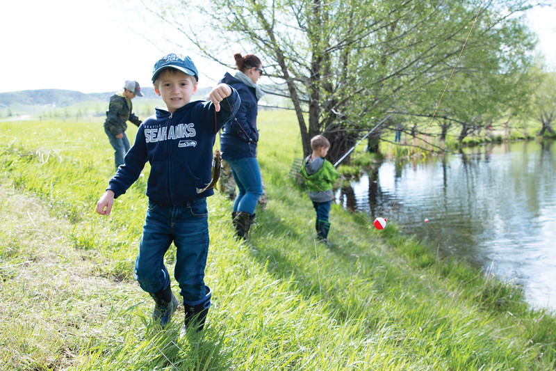 Matthew Gaston | The Sheridan Press<br>Hunter Taylor, 6, holds up his first catch of the day at Wilson Reservoir Thursday, May 23, 2019.