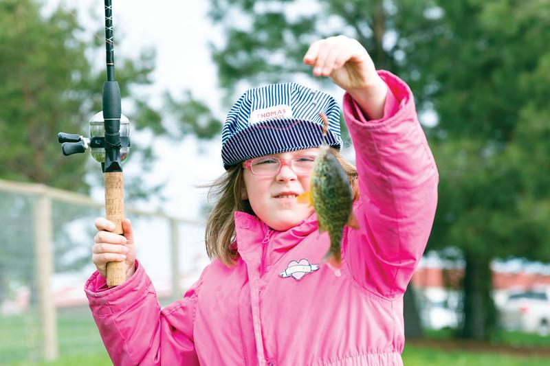Matthew Gaston | The Sheridan Press<br>Big Horn Elementary School kindergartener Chloe Pettengill caught the first fish of the day at Wilson Reservoir Thursday, May 23, 2019.