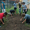 Team of high-school students from Breakthrough Austin (http://www.breakthroughaustin.org/) getting the gardens ready for fall at Nubian Queen Lola's restaurant