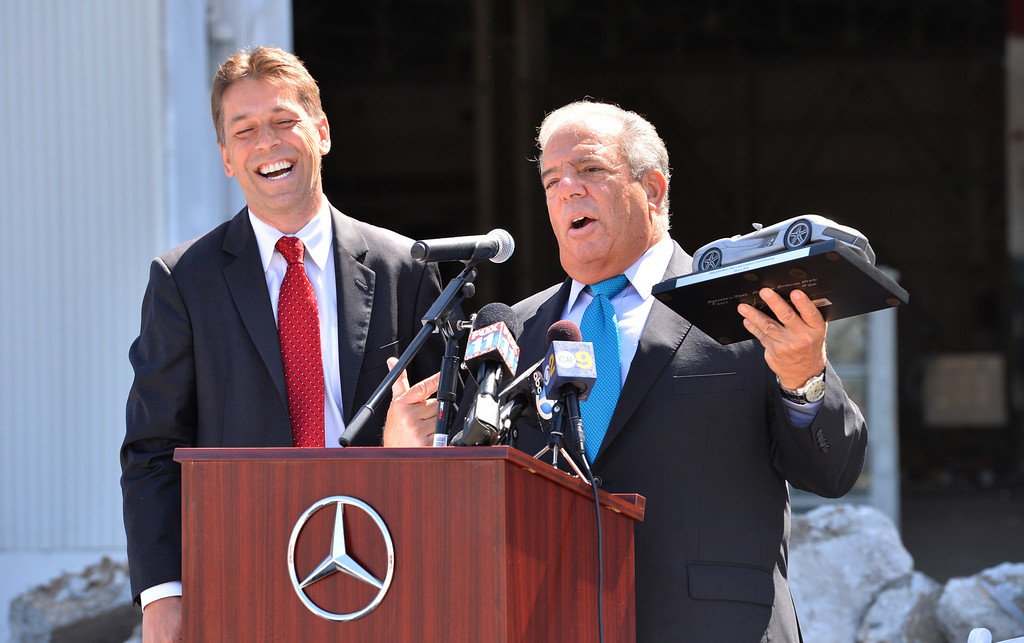 . Dietmar Exler, V.P of Sales for Mercedes-Benz USA and LB Mayor Bob Foster exchange laughs as Foster receives a symbolic new car. Press conference and tour of the new Mercedes-Benz facility in Long Beach. The million sq. ft.  building is a former Boeing shop along Lakewood Blvd.   (June 4, 2014 Photo by Brad Graverson/The Press Telegram)