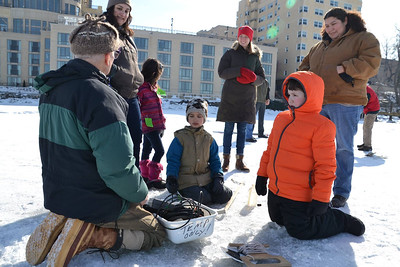 Professor Emeritus of Zoologyand Director Emeritus of the Center for Limnology showing future scientists how to test the waters at the ice science lab.