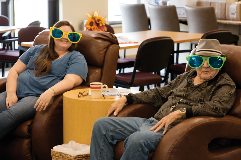Matthew Gaston | The Sheridan Press<br>Gordon Gravning right and Lacey VanHorn left goof around during Daybreak at The Hub Thursday, Nov. 15, 2018.