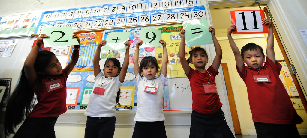 . Kindergarteners Delilah Fauuli (cq),left, Emerie Encisco, Breanna Camacho, Sarai Soto, and Alexander Chea work out math equation at Lafayette Elementary using new Common Core standards on Thursday, November 14, 2013. (Photo by Sean Hiller/Press Telegram).