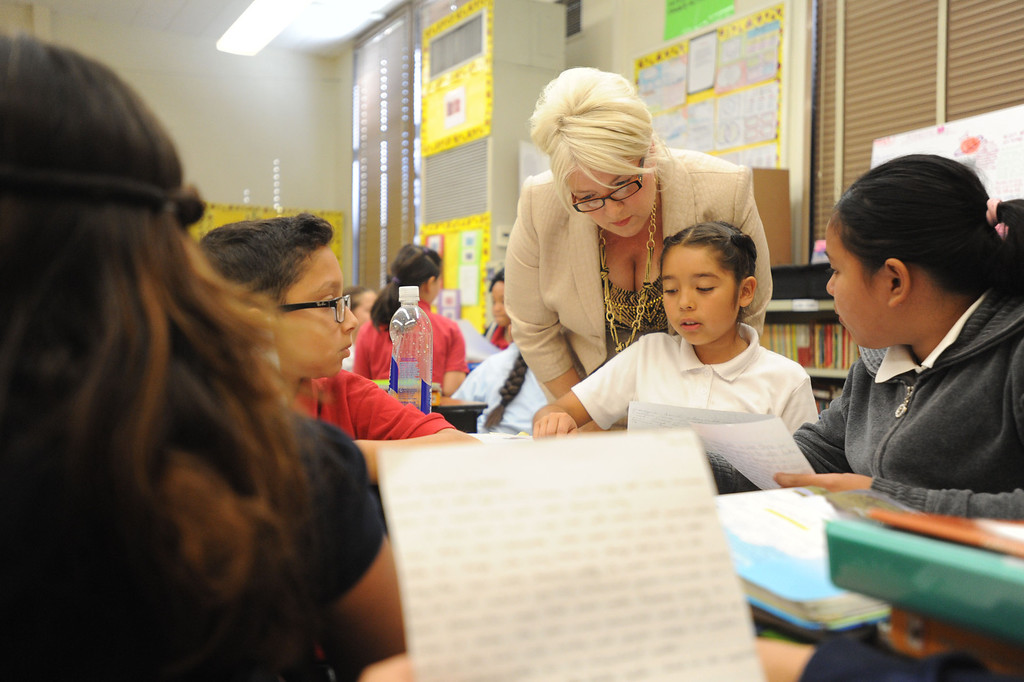 . Principal Wendy Thompson joins in on a discussion with fifth grade students at Lafayette Elementary, which is using the new Common Core standards being put into place at local schools that give schools nationwide common standards in math and English on Thursday, November 14, 2013. (Photo by Sean Hiller/Press Telegram)
