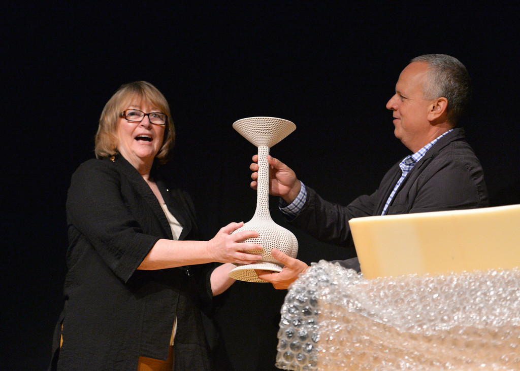 . New CSULB President Jane Close Conoley accept a ceramic sculpture as a gift from the university before her convocation address  at the Carpenter Performing Arts Center on campus.  (Aug. 22 2014 Photo by Brad Graverson/The Press Telegram)