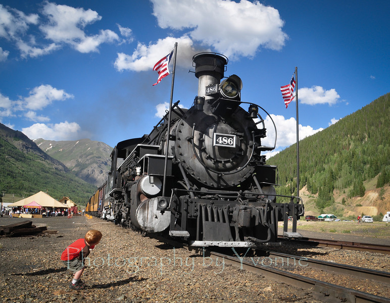 A child sees the locomotive from a different angle as it sits in Silverton waiting for nighttime fireworks for Independence Day.