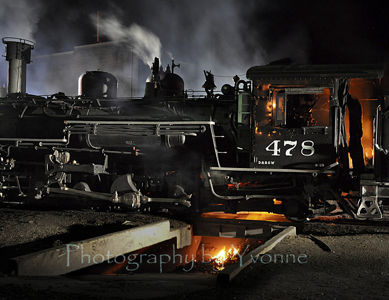Locomotive 478 has its fire shaken over the ashpit in the Durango rail yard.