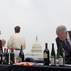 Bart Gordon bids at silent Auction Hearts Delight hosts a Wine auction on the Capitol Rooftop at 101 Constitution Ave