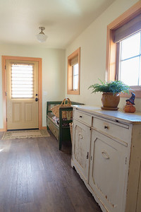 New mudroom entry with fiberglass half lite door (for longevity in a sunny location).  Plank vinyl flooring works well for pets and outdoor shoes.  The windows are vinyl frame Milguard with low-e coating.