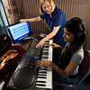 "University of Rochester Eastman School of Music Professor of Music Theory and Brain & Cognitive Sciences Elizabeth West ""Betsy"" Marvin with student Varsha Nair in a soundproof booth used for research at ESM September 19, 2012.  // photo by J. Adam Fenster / University of Rochester"