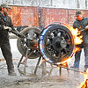 Dave Weik (L) and Dirk Caloccia (R) remove a Shay locomotive tire on a cold January morning in 2012. <br /> <br /> Note: Dave no longer works for the railroad.