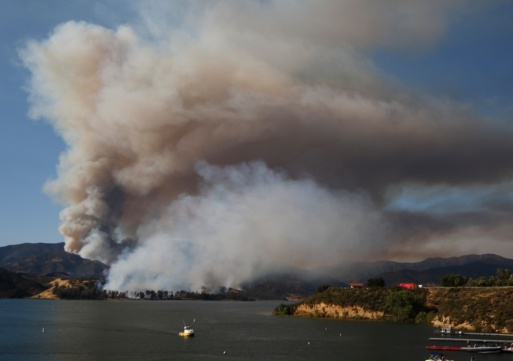 . June 17,2017. Caustic Lake. CA. People were able to enjoy the lake as LA county and LA city firefighters do mostly of air attack on a brush fire near Lake Castaic  Saturday. The fire rapidly has grown to 550+ acres as of 4 p.m.  A total of 195 firefighters from the Los Angeles County Fire Department, plus firefighters from the Angeles National Forest, battled the blaze.  As of 4 p.m., there was no containment line and no mandatory evacuations of the area,  Photo by Gene Blevins/LA DailyNews/SCNG