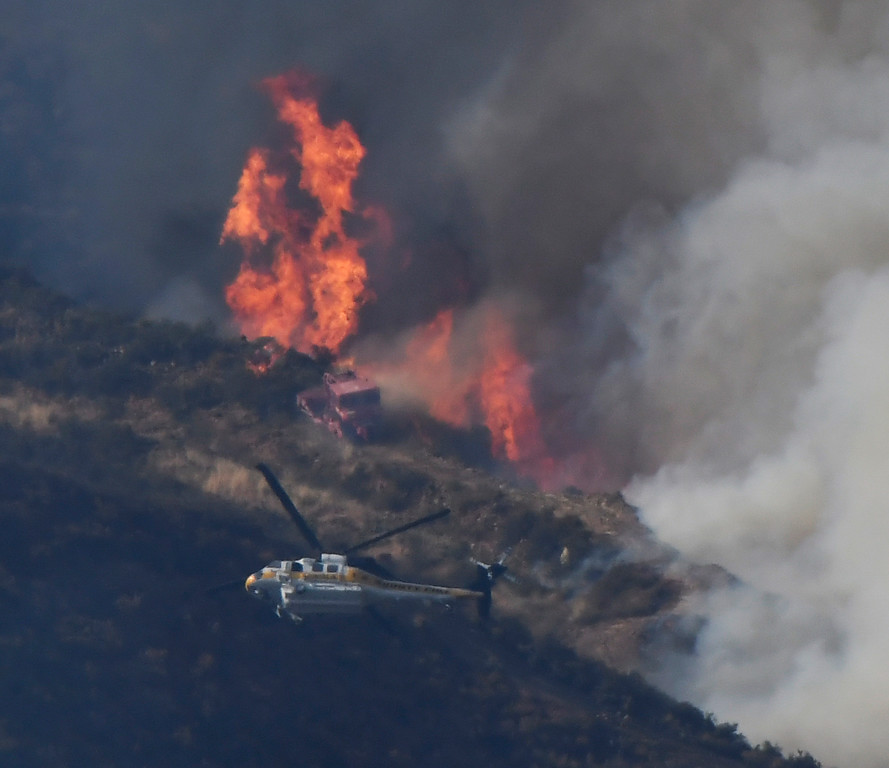 . June 17,2017. Caustic Lake. CA.  A LA county dozer tries to make a line to hold back the heavy flames, as LA county and LA city firefighters do mostly of air attack on a brush fire near Lake Castaic  Saturday. The fire rapidly has grwon to 500 acres as of 4 p.m.  A total of 195 firefighters from the Los Angeles County Fire Department, plus firefighters from the Angeles National Forest, battled the blaze.  As of 4 p.m., there was no containment line and no mandatory evacuations of the area,  Photo by Gene Blevins/LA DailyNews/SCNG