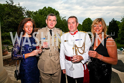 Sheila and Air Attache Ken McCann, Colonel Nigel Brown and Beverly Brown. Photo by Tony Powell. Celebration of the Royal Wedding. Residence of the English Ambassador. April 29, 2011