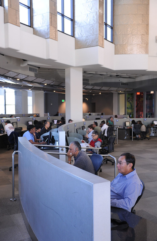 . Eighty five computers for public use in this area. The Cerritos Library is is more like a public information center and gathering place. Lots of books, but also art, music and computers.   (Fri Nov. 8, 2013 Photo by Brad Graverson/The Daily Breeze)