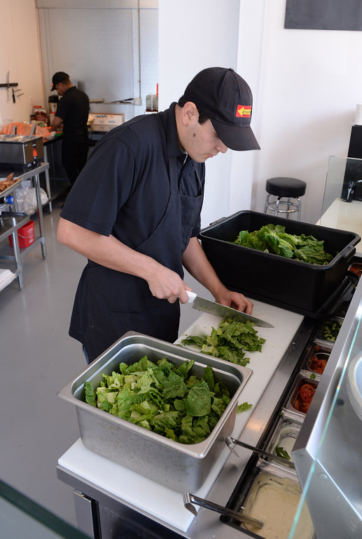 . James Cisneros makes salads. Chayo Eatery in Torrance is a kosher restaurant filling a niche in the local Jewish community. They make fresh pizzas, salads, soups and sandwiches. Photo by Brad Graverson/The Daily Breeze 01/03/14
