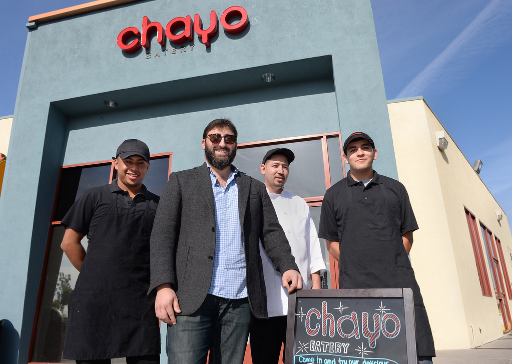 . Chayo Eatery in Torrance is a kosher restaurant filling a niche in the local Jewish community. They make fresh pizzas, salads, soups and sandwiches. Owner Levi Chayo, center, with his food staff. Photo by Brad Graverson/The Daily Breeze 01/03/14