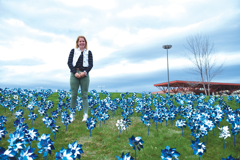 Matthew Gaston | The Sheridan Press<br>Sheridan High School senior Nichole Johnson in collaboration with Big Brothers Big Sisters in Sheridan organized the planting of pinwheels at Sheridan High School to raise awareness for child abuse prevention Wednesday, April 24, 2019.