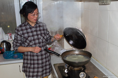 Mu, Ting's mother, cooking the dumplings in boiling water.