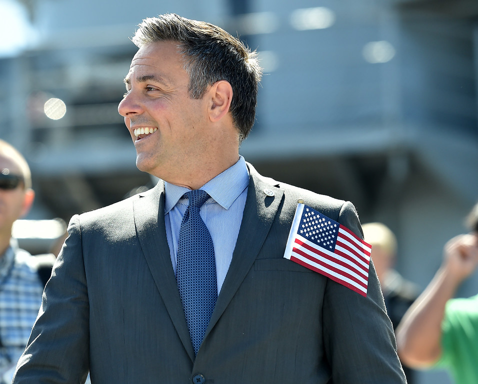 . 40 young people became US citizens Monday morning July 3, 2017 aboard the USS Iowa during Independence Day Citizenship Ceremony with keynote speaker Senator Kamala Harris. Councilman Joe Buscaino sports a flag. Photo by Robert Casillas, Daily Breeze/SCNG