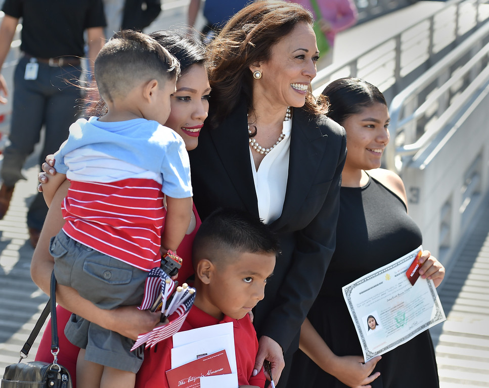 . 40 young people became US citizens Monday morning July 3, 2017 aboard the USS Iowa during Independence Day Citizenship Ceremony with keynote speaker Senator Kamala Harris. Sen. Harris poses with Navarro family after ceremony. Photo by Robert Casillas, Daily Breeze/SCNG