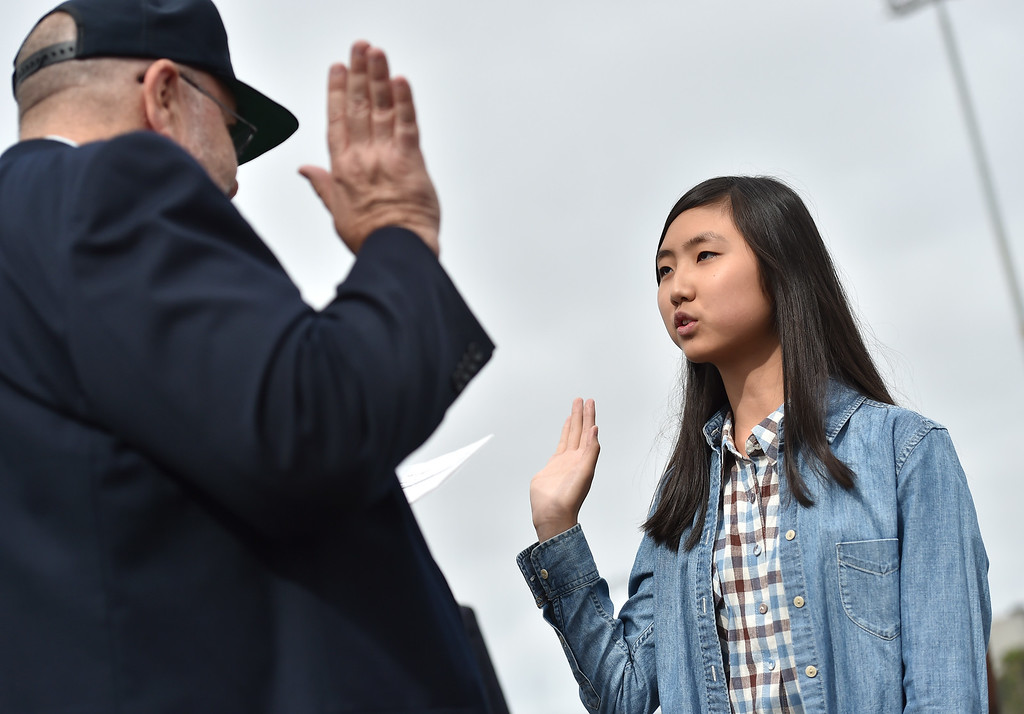 . 40 young people became US citizens Monday morning July 3, 2017 aboard the USS Iowa during Independence Day Citizenship Ceremony with keynote speaker Senator Kamala Harris. Alice Fang, 15, takes oath of citizenship. Photo by Robert Casillas, Daily Breeze/SCNG