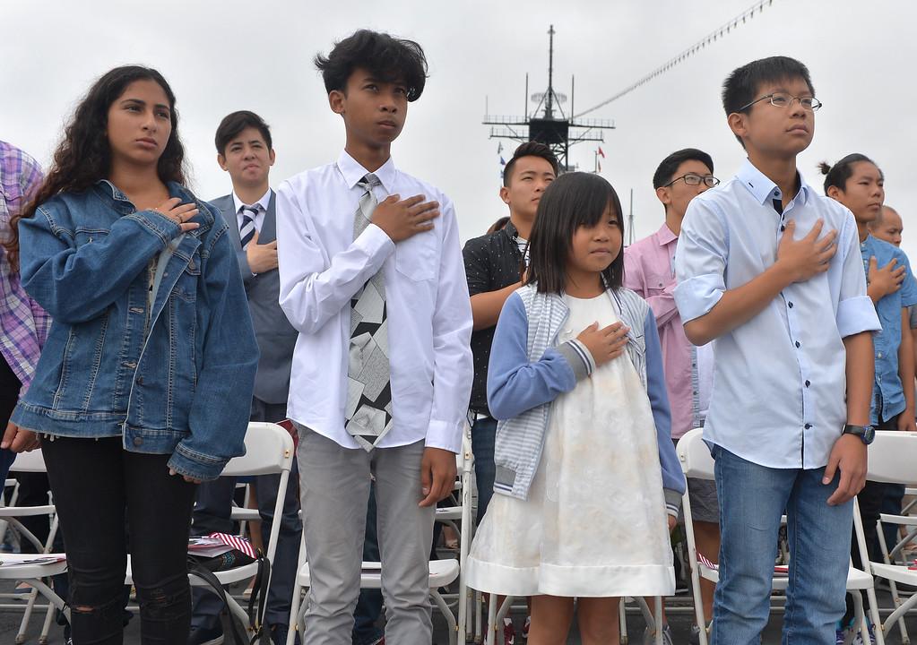 . 40 young people became US citizens Monday morning July 3, 2017 aboard the USS Iowa during Independence Day Citizenship Ceremony with keynote speaker Senator Kamala Harris. New citizens during Pledge of Allegiance. Photo by Robert Casillas, Daily Breeze/SCNG