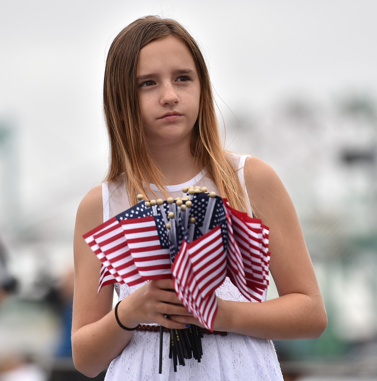 . 40 young people became US citizens Monday morning July 3, 2017 aboard the USS Iowa during Independence Day Citizenship Ceremony with keynote speaker Senator Kamala Harris. Lucia Strizzi hands out flags before ceremony. Photo by Robert Casillas, Daily Breeze/SCNG