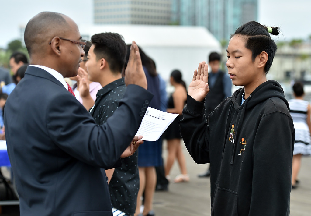 . 40 young people became US citizens Monday morning July 3, 2017 aboard the USS Iowa during Independence Day Citizenship Ceremony with keynote speaker Senator Kamala Harris. Shuo Chen takes oath of citizenship.  Photo by Robert Casillas, Daily Breeze/SCNG