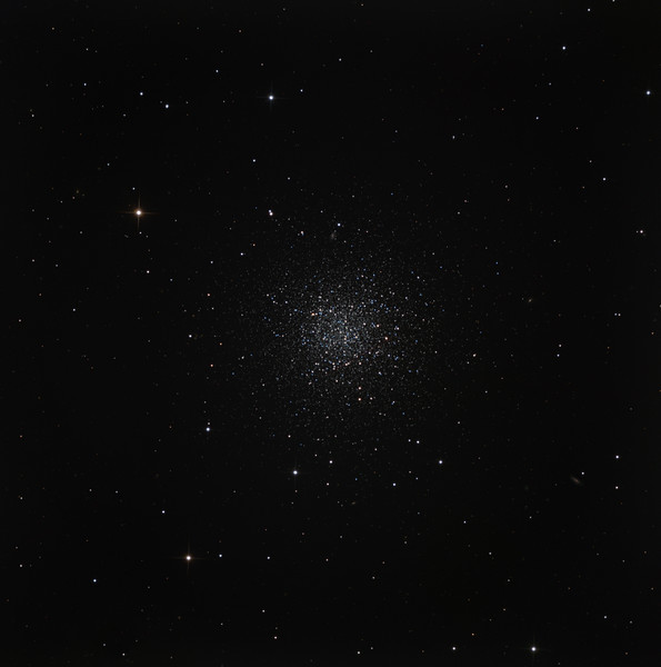 "NGC 288 in Sculptor. A lonely globular cluster near the south galactic pole. Unlike its big brothers and sisters, it's easy to resolve stars right to the core. Note the distant face-on spiral galaxy shining through the outskirts of the globular at about 12 o'clock. <br /> RGB 1.5 hours each in 30 min subs. Aspen CG16M on 20"" PlaneWave. Field approx half a degree. Taken at half moon on a blistering hot evening with poor seeing."