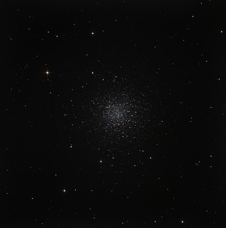"NGC 288 in Sculptor. A lonely globular cluster near the south galactic pole. Unlike its big brothers and sisters, it's easy to resolve stars right to the core. Note the distant face-on spiral galaxy shining through the outskirts of the globular at about 12 o'clock.  RGB 1.5 hours each in 30 min subs. Aspen CG16M on 20"" PlaneWave. Field approx half a degree. Taken at half moon on a blistering hot evening with poor seeing."