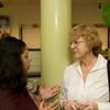 Karen Mejia and Dr. Karen Eberle-McCarthy conversate at the M&T Bank celebration of Hispanic Heritage Month in Newburgh on Wednesday, October 3, 2012. Hudson Valley Press/CHUCK STEWART, JR.