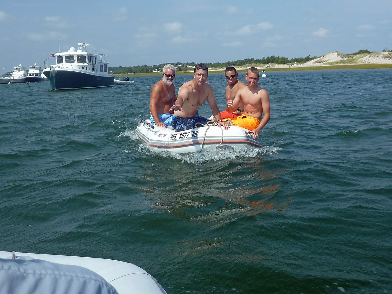 Why are 'Em and Robby on a stranger's dinghy and all wet?